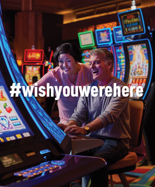 "couple at slot machine with text ""#WishYouWereHere"""